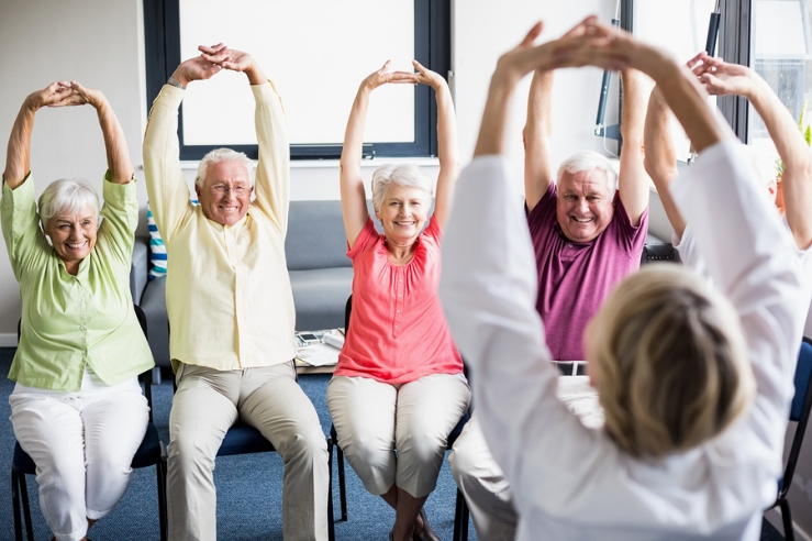 bigstock-Seniors-doing-exercises-in-a-r-138261863